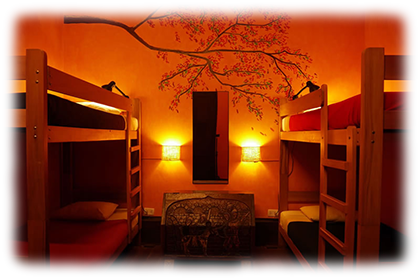 4 Beds in Private Room<br><br>First floor private dormitory with 2 bunk beds and shared bathroom.<br><br><small>Includes personal lamps, personal security lockers, a mirror, a fan, towels, sheets, pillows, extra blankets and breakfast.<br>(Click on the picture)</small>