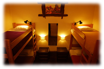 3 Beds in Private Room<br><br>First floor private dormitory with 2 bunk beds and shared bathroom.<br><br><small>Includes personal lamps, personal security lockers, a mirror, a fan, towels, sheets, pillows, extra blankets and breakfast.<br>(Click on the picture)</small>